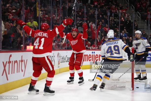 Tyler Bertuzzi of the Detroit Red Wings celebrates his second period goal with Luke Glendening while playing the David Perron at Little Caesars Arena...