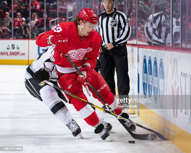 Tyler Bertuzzi of the Detroit Red Wings controls the puck along the boards against the Los Angeles Kings during an NHL game at Little Caesars Arena...