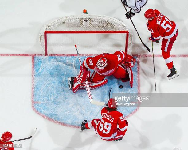 Tyler Bertuzzi of the Detroit Red Wings digs for the rebound on a save by Jimmy Howard during an NHL game at Little Caesars Arena on December 10 2018...