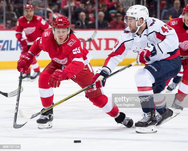 Tyler Bertuzzi of the Detroit Red Wings races after the puck with Tom Wilson of the Washington Capitals during an NHL game at Little Caesars Arena on...