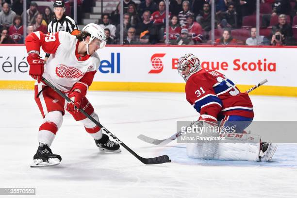 Tyler Bertuzzi of the Detroit Red Wings skates the puck in all alone on goaltender Carey Price of the Montreal Canadiens during the NHL game at the...