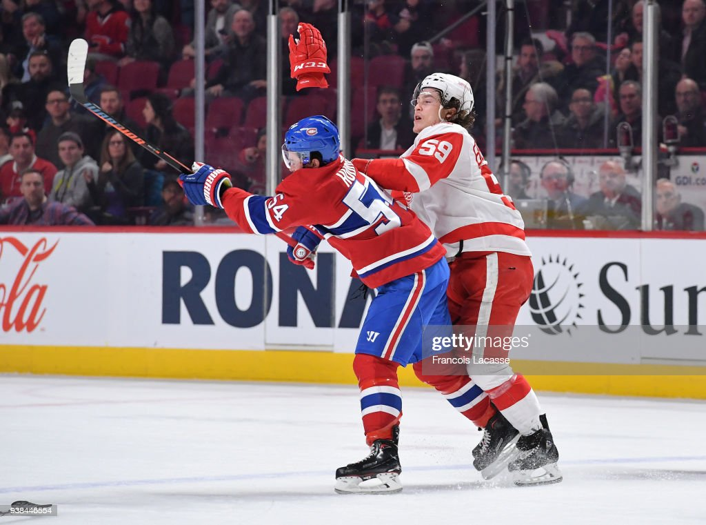 Tyler Bertuzzi #59 of the Detroit Red Wings starts the fight against Charles Hudon #54 of the Montreal Canadiens in the NHL game at the Bell Centre on March 26, 2018 in Montreal, Quebec, Canada.
