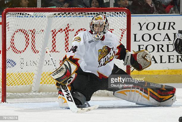 Tyler Beskorowany of the Owen Sound Attack slides across the net to stop a shot in a game against the London Knights on January 18 2008 at the John...