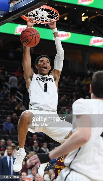 Tyler Bey of the Colorado Buffaloes dunks against the Arizona State Sun Devils during a firstround game of the Pac12 basketball tournament at TMobile...