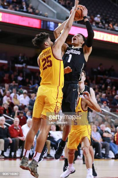 Tyler Bey of the Colorado Buffaloes handles the ball against Bennie Boatwright of the USC Trojans during a PAC12 college basketball game at Galen...