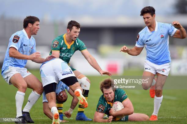Tyler Blackburn of Mid Canterbury is tackled during the round six Heartland Championship match between Mid Canterbury and East Coast on September 29...