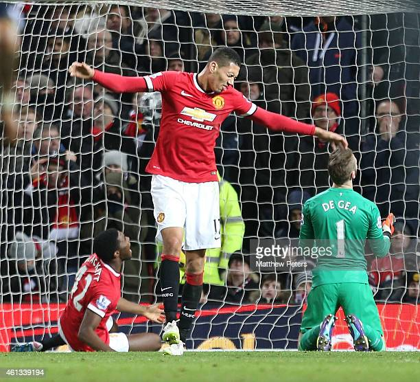 Tyler Blackett Chris Smalling and David de Gea of Manchester United react to conceding a goal during the Barclays Premier League match between...
