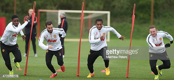 Tyler Blackett, Juan Mata, Antonio Valencia and Wayne Rooney of Manchester United in action during a first team training session at Aon Training...