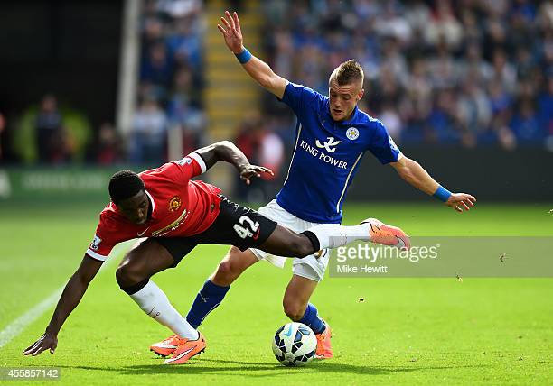 Tyler Blackett of Manchester United and Jamie Vardy of Leicester City compete for the ball during the Barclays Premier League match between Leicester...