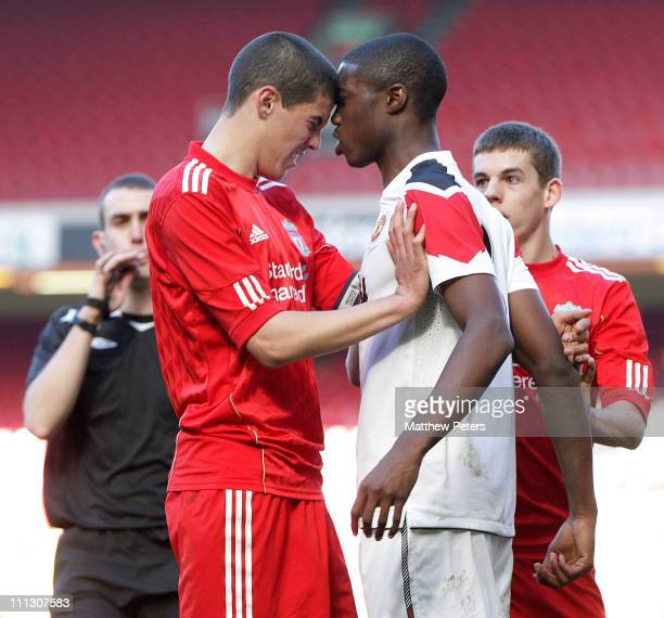Tyler Blackett of Manchester United clashes with Conor Coady of Liverpool before the pair went sent off during the FA Youth Cup sponsored by Eon...