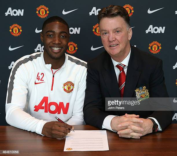 Tyler Blackett of Manchester United poses with Manager Louis van Gaal after signing a contract extension at Aon Training Complex on February 27, 2015...