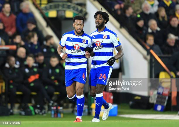 Tyler Blackett of Reading and Liam Moore celebrate after teammate Yakou Meite scores their team's first goal during the Sky Bet Championship match...