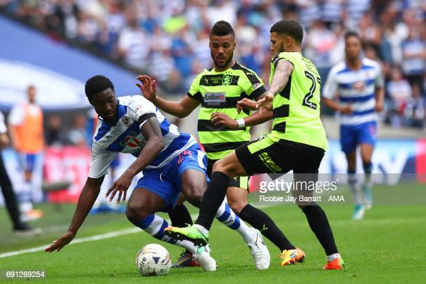 Tyler Blackett of Reading and Nahki Wells of Huddersfield Town during the Sky Bet Championship Play Off Final match between Reading and Huddersfield...