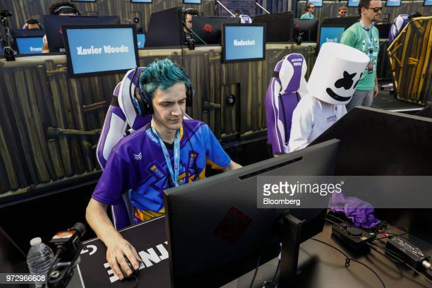 Tyler Blevins known as Ninja left and DJ Christopher Comstock known as Marshmello prepare to compete in Epic Games Inc's Fortnite Battle Royale...
