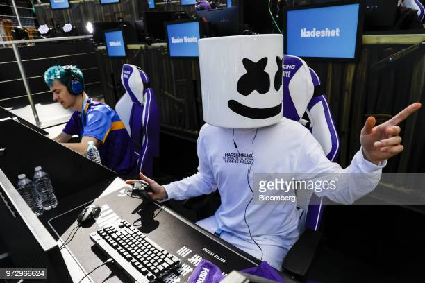 Tyler Blevins known as Ninja left and DJ Christopher Comstock known as Marshmello prepare to compete in the Epic Games Inc Fortnite Battle Royale...
