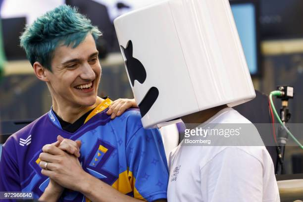 Tyler Blevins known as Ninja left talks to DJ Christopher Comstock known as Marshmello after winning the Epic Games Inc Fortnite Battle Royale...