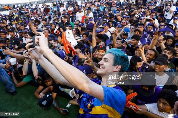 Tyler Blevins known as Ninja takes a selfie photograph with attendees after winning the Epic Games Inc Fortnite Battle Royale Celebrity Pro Am on the...