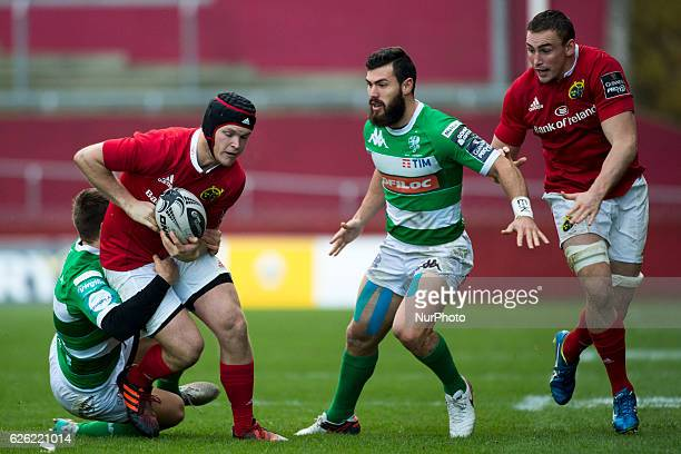 Tyler Bleyendaal of Munster tackled by Luca Serandio of Beneton during the Guinness PRO12 Round 9 match between Munster Rugby and Benetton Treviso at...