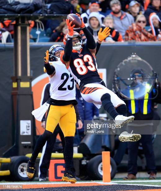 Tyler Boyd of the Cincinnati Bengals catches a touchdown pass while defended by Joe Haden of the Pittsburgh Steelers during the game at Paul Brown...