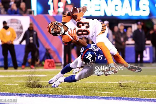 Tyler Boyd of the Cincinnati Bengals gets hit by Trevin Wade of the New York Giants to make an incomplete pass during the third quarter of the game...
