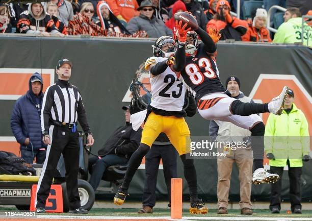 Tyler Boyd of the Cincinnati Bengals goes up for a touchdown catch as Joe Haden of the Pittsburgh Steelers defends during the first half at Paul...