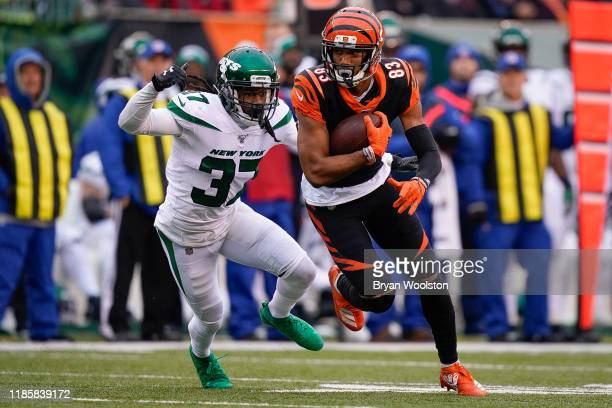 Tyler Boyd of the Cincinnati Bengals runs with the ball during the first half of NFL football game against the New York Jets at Paul Brown Stadium on...