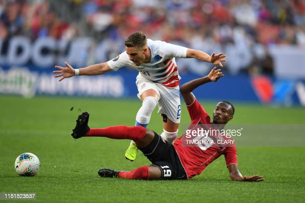 TOPSHOT Tyler Boyd of the US vies for the ball with Kevan George of Trinidad and Tobago during their CONCACAF Gold Cup group stage football match at...