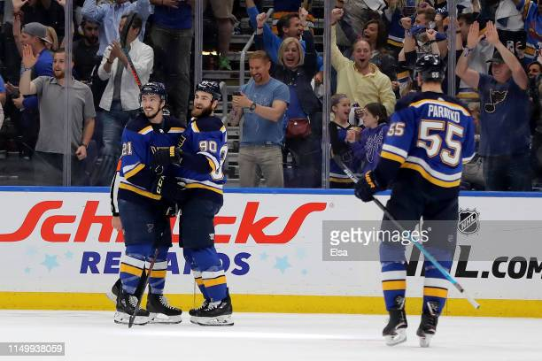 Tyler Bozak and Ryan O'Reilly of the St Louis Blues celebrate with Colton Parayko after a goal scored on Martin Jones of the San Jose Sharks during...