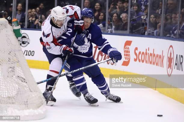TORONTO ON APRIL 17 Tyler Bozak battles past John Carlson as the Toronto Maple Leafs play the Washington Capitals in game three of their NHL first...