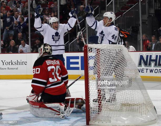 Tyler Bozak celebrates a score by Joey Crabb of the Toronto Maple Leafs at 8:37 of the first period against Martin Brodeur of the New Jersey Devils...