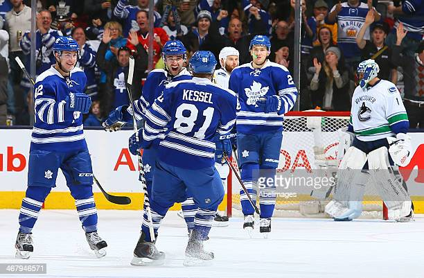 Tyler Bozak Nazem Kadri and Phil Kessel of the Toronto Maple Leafs celebrate Kessel's goal against the Vancouver Canucks during NHL action at the Air...