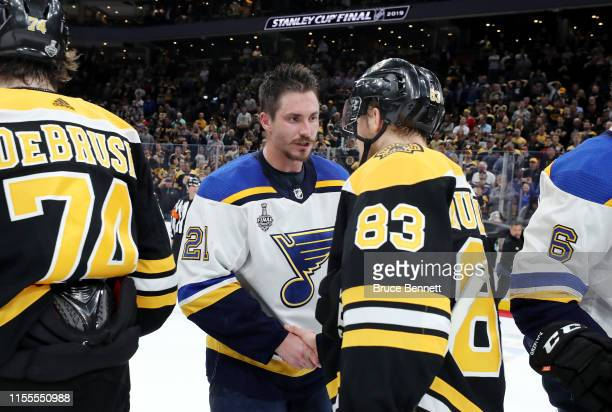 Tyler Bozak of the St Louis Blues and Karson Kuhlman of the Boston Bruins shake hands after Game Seven of the 2019 NHL Stanley Cup Final at TD Garden...