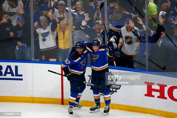 Tyler Bozak of the St Louis Blues celebrates with David Perron after scoring a goal on Martin Jones of the San Jose Sharks during the third period in...