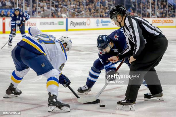 Tyler Bozak of the St Louis Blues takes a second period faceoff against Bryan Little of the Winnipeg Jets at the Bell MTS Place on October 22 2018 in...