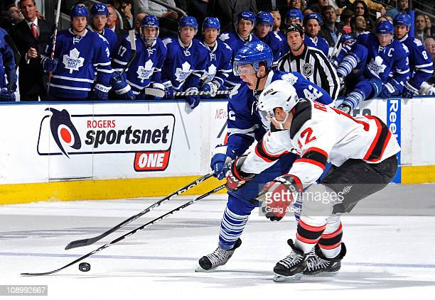 Tyler Bozak of the Toronto Maple Leafs battles for the puck with Brian Rolston of the New Jersey Devils during game action February 10, 2011 at the...