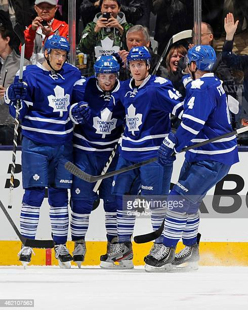 Tyler Bozak of the Toronto Maple Leafs celebrates his first period goal with teammates during NHL game action against the New Jersey Devils January...