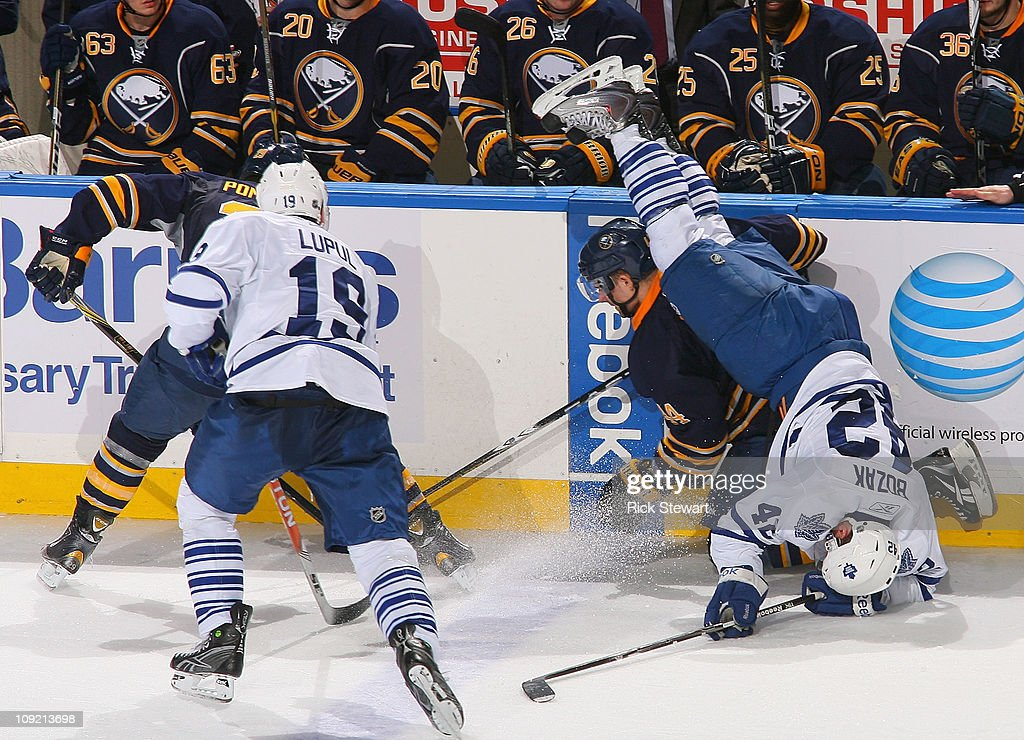 Tyler Bozak #42 of the Toronto Maple Leafs flips over Andrej Sekera #44 of the Buffalo Sabres at HSBC Arena on February 16, 2011 in Buffalo, New York.