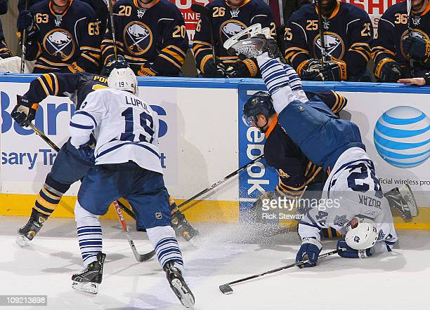 Tyler Bozak of the Toronto Maple Leafs flips over Andrej Sekera of the Buffalo Sabres at HSBC Arena on February 16 2011 in Buffalo New York