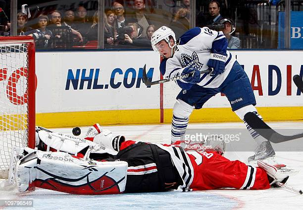 Tyler Bozak of the Toronto Maple Leafs gets stopped by Corey Crawford of the Chicago Blackhawks during game action at the Air Canada Centre March 5,...