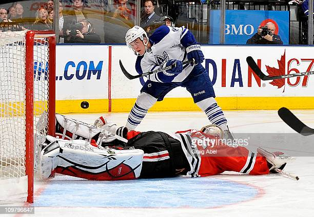Tyler Bozak of the Toronto Maple Leafs is stopped in close by Corey Crawford of the Chicago Blackhawks March 5, 2011 at the Air Canada Centre in...