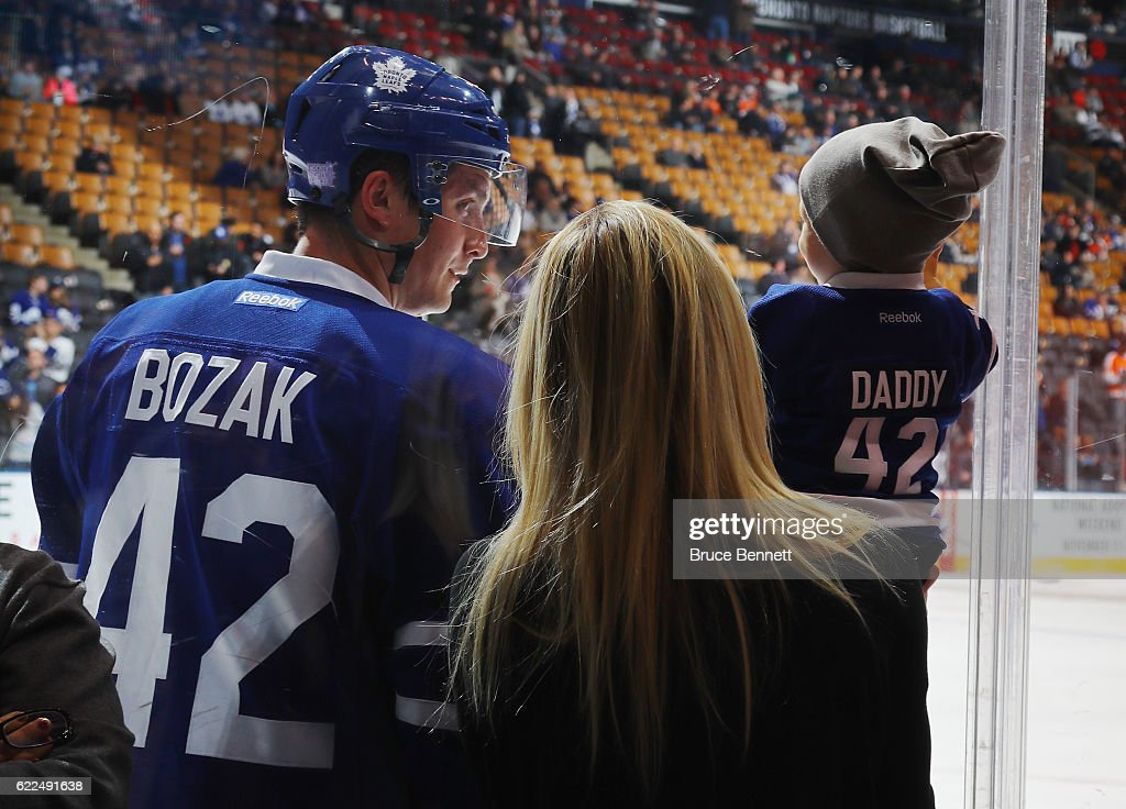 Tyler Bozak #42 of the Toronto Maple Leafs looks at his son and wife during warmups prior to the game against the Philadelphia Flyers at the Air Canada Centre on November 11, 2016 in Toronto, Canada.