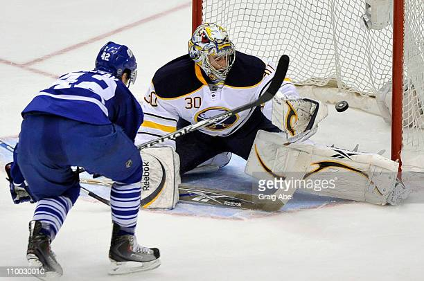 Tyler Bozak of the Toronto Maple Leafs scores a second period goal on Ryan Miller of the Buffalo Sabres March 12, 2011 at the Air Canada Centre in...