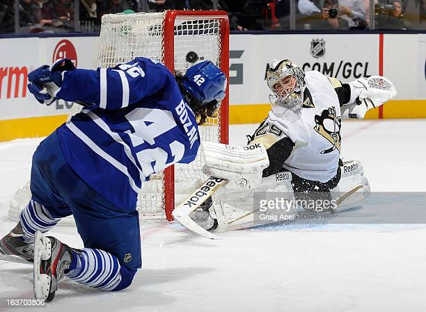 Tyler Bozak of the Toronto Maple Leafs scores a second-period goal on Marc-Andre Fleury of the Pittsburgh Penguins during NHL game action March 14,...