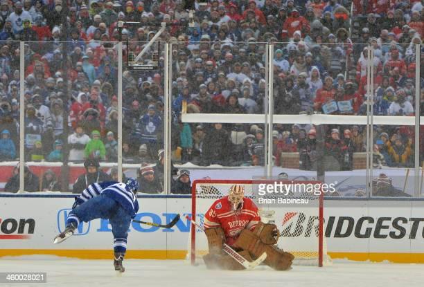 Tyler Bozak of the Toronto Maple Leafs scores on goaltender Jimmy Howard of the Detroit Red Wings during shootout overtime of the 2014 Bridgestone...