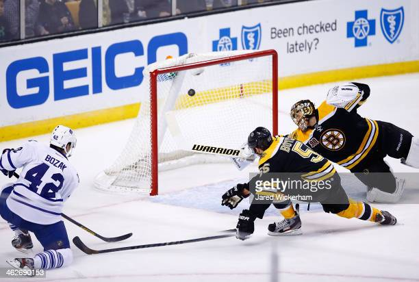 Tyler Bozak of the Toronto Maple Leafs shoots and scores his second goal past Tuukka Rask of the Boston Bruins in the second period during the game...