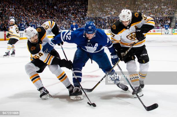 Tyler Bozak of the Toronto Maple Leafs skates against Adam McQuaid and Patrice Bergeron of the Boston Bruins in Game Three of the Eastern Conference...