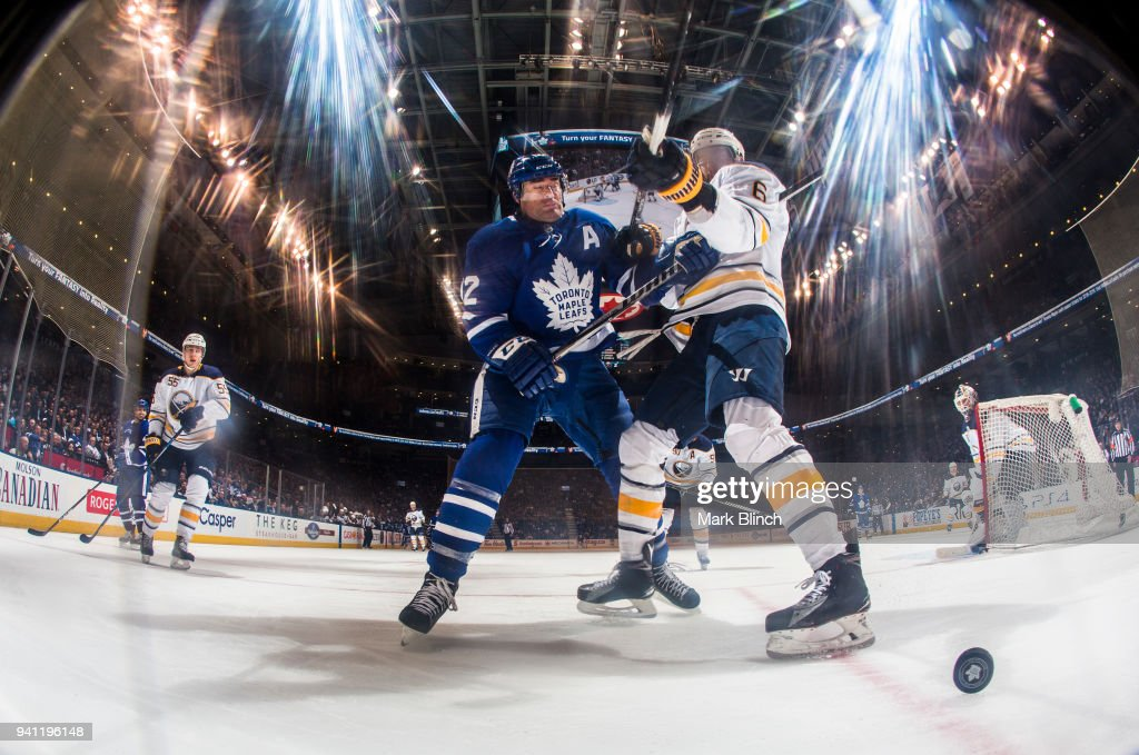 Tyler Bozak #42 of the Toronto Maple Leafs skates against Marco Scandella #6 of the Buffalo Sabres during the third period at the Air Canada Centre on April 2, 2018 in Toronto, Ontario, Canada.