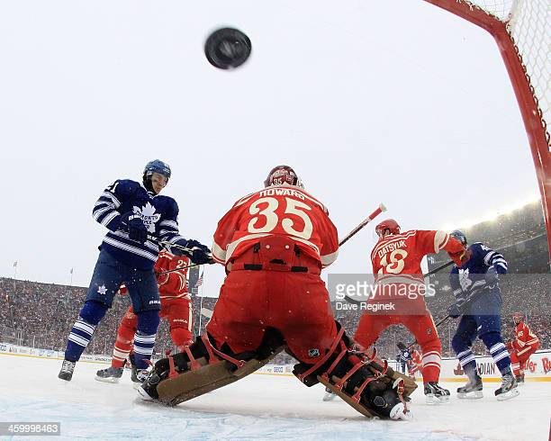 Tyler Bozak of the Toronto Maple Leafs tips in the puck past Jimmy Howard of the Detroit Red Wings to take the lead in the 3rd period of...