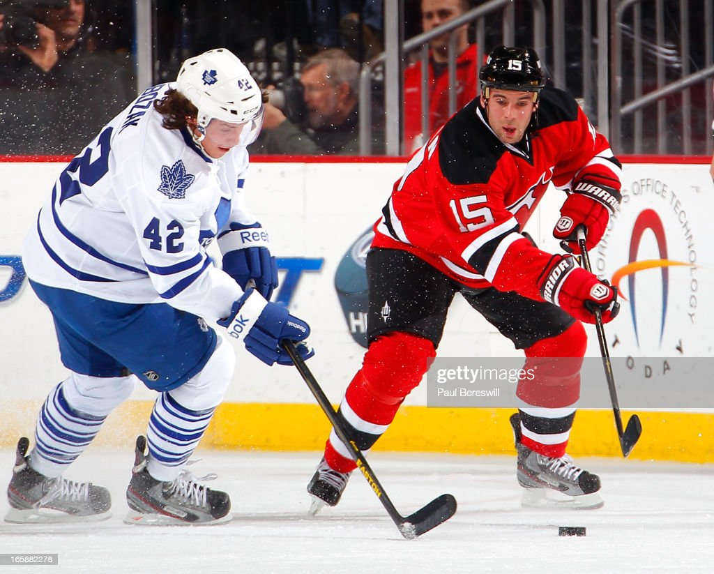 Tyler Bozak #42 of the Toronto Maple Leafs tries to stop Steve Sullivan #15 of the New Jersey Devils from passing in the second period of an NHL hockey game at Prudential Center on April 6, 2013 in Newark, New Jersey. The Leafs won 2-1.