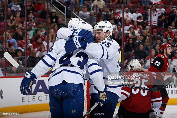 Tyler Bozak PA Parenteau and Nazem Kadri of the Toronto Maple Leafs celebrate after Kadri scored a second period goal against goaltender Louis...